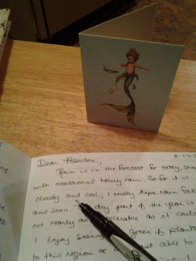 current letter book and baby Poseidon image.